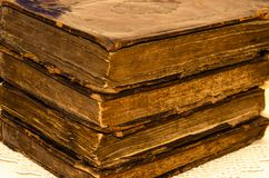 Stack of old and worn leather cover books with gold leaf embossing royalty free stock photo
