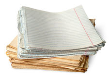 Stack of old yellowed sheets of school notebooks. Isolated on white background stock photography