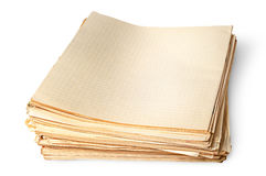 Stack of old yellowed sheets of school notebooks top view. Isolated on white background royalty free stock photography