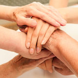 Stack of old and young hands. Showing generations Stock Photos
