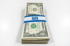 Stack of One Dollar Bills with Currency Strap. Stack of one dollar bills with $100 paper currency strap royalty free stock images