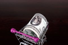 Dollar Banknotes with Shopping Cart Consuming Concept Stock Photography