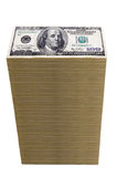 Stack of one hundred dollar bills. A tower of one hundred dollar bills isolated on white Stock Photography
