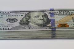 Stack of one hundred dollar bills. American dollar money Franklin portrait close-up Stock Photos