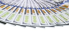 Stack of one hundred dollar bills. Stack of cash money in hundred dollar banknotes. Heap of hundred dollar bills isolated on white. Background stock photography
