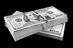 Stack of one hundred dollar bills isolated on black background. Stack of cash money in hundred dollar banknotes. Heap of hundred d. Ollar bills background royalty free stock photos
