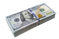 Stack of one hundred dollar bills isolated on white background. Stack of cash money in hundred dollar banknotes. Heap of hundred d. Ollar bills background royalty free stock photos