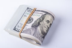 Stack of one hundred dollar bills with rubberband Royalty Free Stock Photography