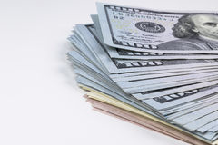 Stack of one hundred dollar bills. Stack of cash money in hundred dollar banknotes. Heap of hundred dollar bills on white Royalty Free Stock Images