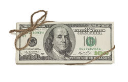 Stack of One Hundred Dollar Bills Tied in a Burlap String on Whi Royalty Free Stock Image