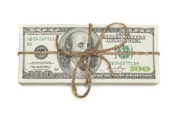 Stack of One Hundred Dollar Bills Tied in a Burlap String on Whi Stock Photos