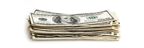 A stack of one hundred dollar bills on a white background. Isolated Stock Images