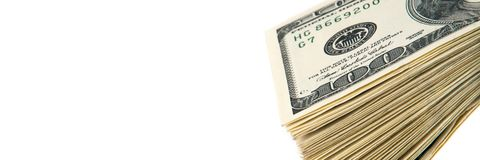 A stack of one hundred dollar bills on a white background. Isolated. royalty free stock images