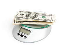Stack of one hundred dollars on a  Scales Stock Photography