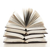 Stack of open books. Stack of open old fanned hardcover leather bound books Stock Photos