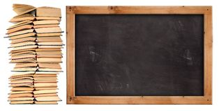 Stack of open  books with school blackboard. On white background Stock Photography