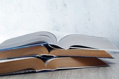 A stack of open books. Three open big books symbolizing education and study royalty free stock images
