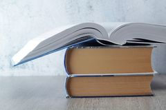 A stack of open books. Three open big books symbolizing education and study royalty free stock image