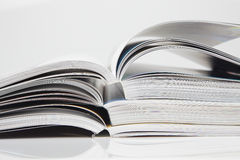 Stack of open magazines Stock Photography