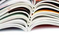 Stack of Open Magazines Royalty Free Stock Images