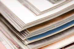 Stack of open magazines Stock Photo