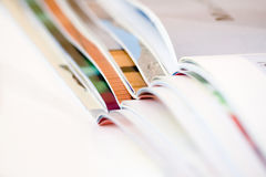 Stack of open magazines - shallow dof Stock Image