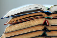 Stack of opened old books, horizontal background stock images