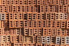 Stack of orange Brick block. In residential building construction site Stock Photos