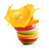 Stack of orange fruit and apples slices Stock Image
