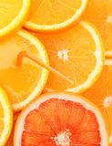 Stack of orange fruit slices with juice. Stock Images
