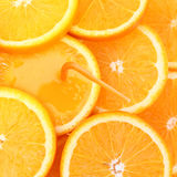 Stack of orange fruit slices with juice. Stock Image