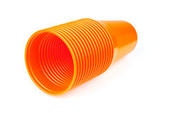 Stack of orange plastic cups Stock Images