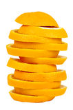Stack of orange slices on white background Royalty Free Stock Image