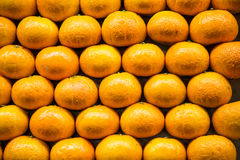 Stack of Oranges in Market Stock Photo