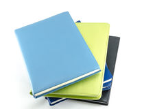 Stack of organizers placed on isolated background Stock Photo