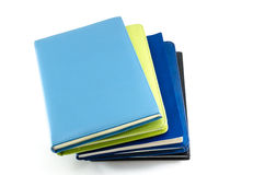 Stack of organizers placed on isolated background Royalty Free Stock Photo