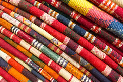 Stack of original Persian carpets Royalty Free Stock Photos