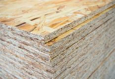 A stack of OSB sheets stacked one on another.  stock photos