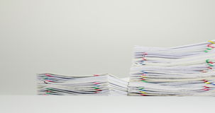 Stack overload paperwork on white table time lapse