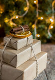 Stack of packed gifts on the background of Christmas lights Royalty Free Stock Photos