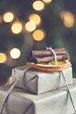 Stack of packed gifts on the background of Christmas lights effe Royalty Free Stock Image