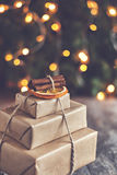 Stack of packed gifts on the background of Christmas lights effe Stock Images
