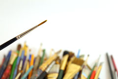 Stack of Paintbrushes. Pile of used paintbrushes isolated on white background with copy space Stock Photo