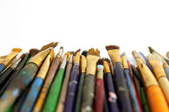 Stack of Paintbrushes. Pile of used paintbrushes isolated on white background with copy space Stock Photography