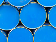 Stack of painted blue oil barrels Stock Photo