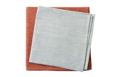 Stack of pale gray and brown napkins on white royalty free stock photos