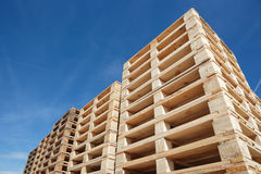 Stack of pallets. Against blue sky Royalty Free Stock Photography