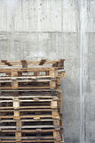 Stack Of Pallets Against Concrete Wall Royalty Free Stock Photography
