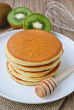 Stack of pancake on white plate and sackcloth with kiwi slices o Stock Images