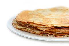 Stack of Pancakes. A stack of pancakes with melted butter and slathered with syrup oozing over the sides Stock Photo